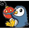 Пингвин играет с новогодней игрушкой